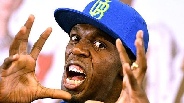 Usain Bolt playfully gestures for the cameras at this Rome press conference on Tuesday.