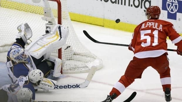 St. Louis Blues goalie Jake Allen deflected a shot by Detroit Red Wings centre Valtteri Filppula on Wednesday night. Allen, of Fredericton, registered his first NHL win in the game.