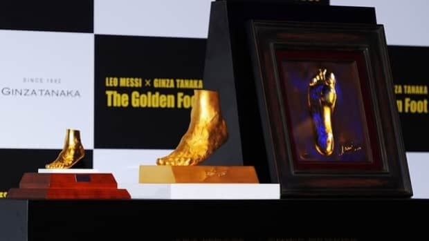 Pure gold replicas of Lionel Messi foot and footprint on display Wednesday in Tokyo, Japan.