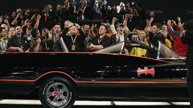 Spectators cheer as the original Batmobile is sold for $4.2 million US during Saturday's Barrett-Jackson collectors car auction in Scottsdale, Arizona.