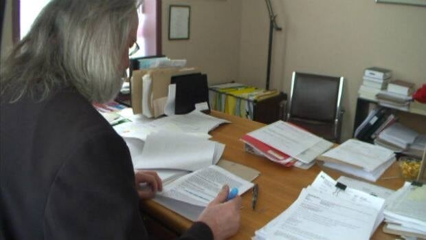 Ray Kuszelewski, the area director of legal aid for central Newfoundland, has been suspended for speaking out on provincial budget cuts to the justice system.