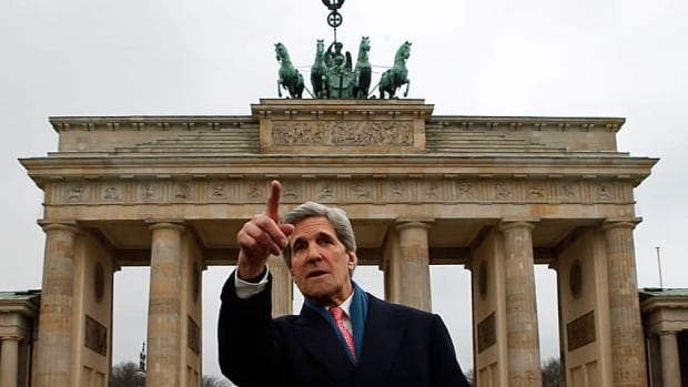 U.S. Secretary of State John Kerry gestures as he stands in front of the Brandenburg Gate in Berlin. Kerry is on a nine-nation, 11-day trip that will also take him to Paris, Rome, Ankara, Cairo, Riyadh, Abu Dhabi and Doha.