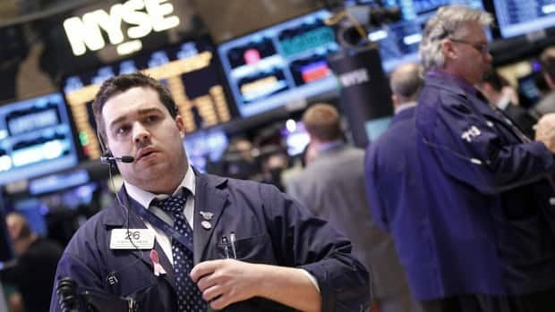The Dow Jones industrial average closed above 15,000 for the first time ever on Tuesday as the world's best known stock market measure extended its recent rally.