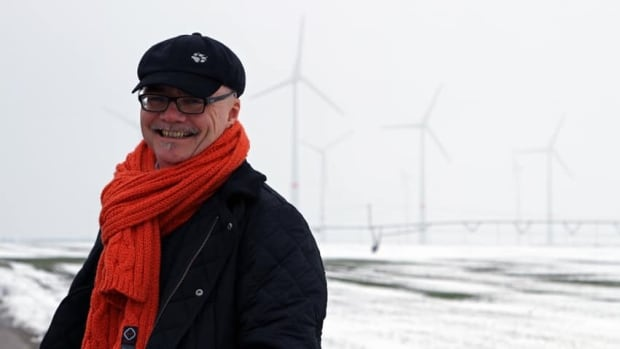 Energiequelle spokesperson Werner Frohwitter stands in front of 43 wind turbines his company put up in Feldheim. It's the only Germany community using only renewable energy, hooked up to its own energy grid.