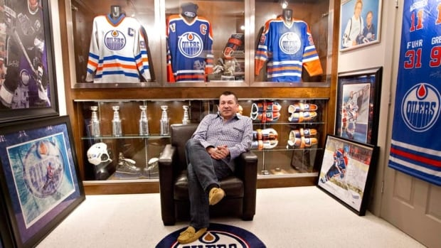 Shawn Chaulk poses with his collection of Wayne Gretzky memorabilia in Fort McMurray, Alta., on Wednesday April 16, 2013.