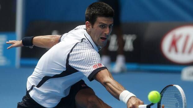 Novak Djokovic reaches for a backhand return in Friday's 6-4, 6-3, 7-5 win over Radek Stepanek.