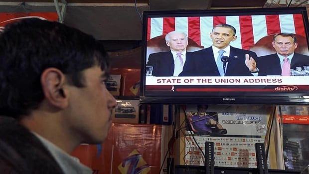 A man watches U.S. President Barack Obama's state of the union speech last week. Starting in the fall, Nielsen ratings will include broadcasts viewed online.