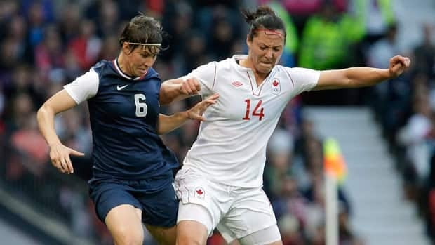 Canada's Melissa Tancredi, right, battles with American Amy Le Peilbet during the bitterly contested Olympic quarter-final match in August.