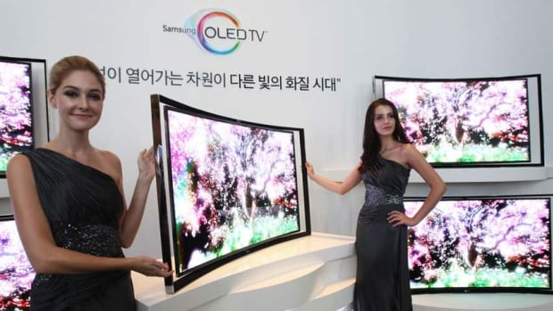 Samsung rolled out a curved TV that uses an advanced display called OLED on Thursday, about a month after its rival LG Electronics Inc., the second-biggest TV maker, launched a 55-inch curved TV in South Korea.