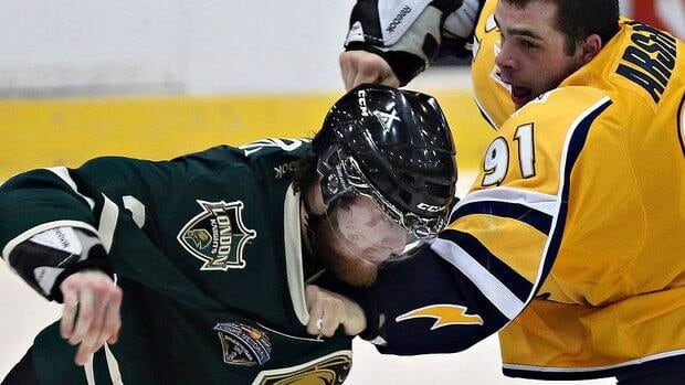 Brett Cook, left, seen in May 2012 as a member of the Ontario Hockey League's London Knights, will never play another Canadian university hockey game after punching a game official.