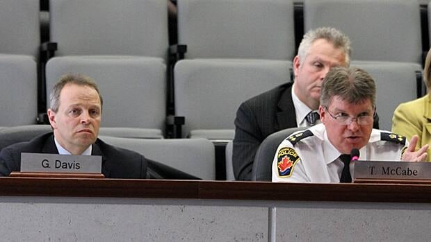 Deputy Chief Ken Leendertse from Hamilton Police Service, right, explains the budget to councillors as Ted Mason, the service's chief accountant, looks on. Hamilton's general issues committee voted down the police budget on Wednesday, which could ultimately lead to provincial arbitration. (Samantha Craggs/CBC)