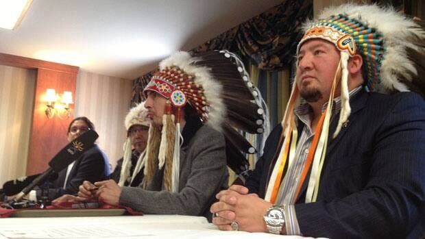 Assembly of Manitoba Chiefs Grand Chief Derek Nepinak sits at a press conference expressing environmental concerns over the proposed Reed Lake Mine in northwestern Manitoba.