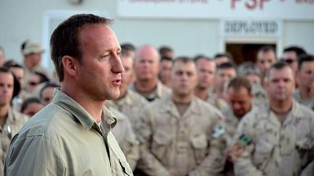 A spokesman for Defence Minister Peter MacKay, seen here speaking to troops at Kandahar Airfield as Canada's combat mission in Afghanistan ended in July 2011, says it wouldn't be right to penalize troops and their families for the department's administrative errors on danger pay.