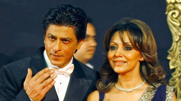 Bollywood superstar Shah Rukh Khan, seen with his wife Gauri in Mumbai in November, has announced the couple are parents to a new baby, born through a surrogate.