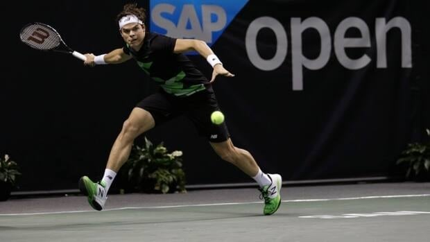 Canada's Milos Raonic returns to Michael Russell during a second round match at the SAP Open tennis tournament in San Jose, Calif., Thursday, Feb. 14, 2013. Raonic won 6-2, 7-5.