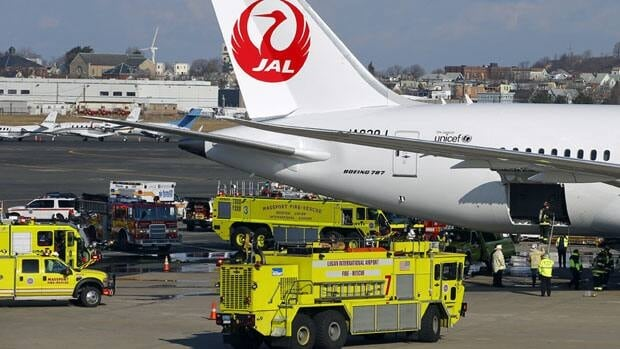 Fire trucks surround Japan Airlines Boeing 787 Dreamliner that caught fire at Logan International Airport in Boston in January.