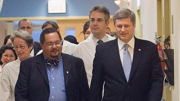 Arthur Porter, left, gave Prime Minister Stephen Harper a tour of the Montreal General Hospital in 2006. Harper later appointed Porter to head Canada's spy watchdog, the Security Intelligence Review Committee.
