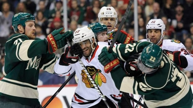 Kyle Brodziak (21) and Cal Clutterbuck (22) of the Minnesota Wild expect more feistiness from Johnny Oduya and the Chicago Blackhawks when the two teams square off for Game 4 on Tuesday.