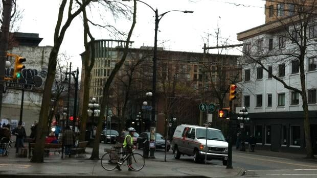 High-end Pidgin restaurant (on the right) sits directly opposite notorious Pigeon Park (on the left).