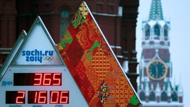 An Olympic countdown clock sits outside the Kremlin in Manezh Square, with Kremlin's Spassky Tower at right in the background, in Moscow.