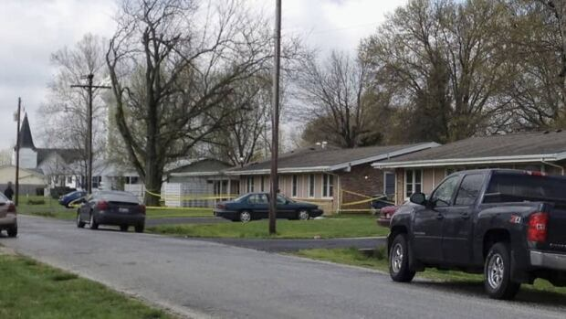 Police tape is seen around a house in Manchester, Ill., where the bodies of five people were found slain early Wednesday in the tiny southwestern Illinois town.