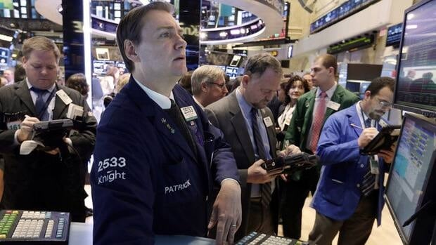 The so-called January barometer suggests that if the stock market goes up in January, it will be up at the end of the year, and vice versa. Specialist Patrick King works on the floor of the New York Stock Exchange, Jan. 8.