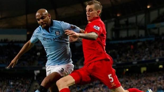 Manchester City's Maicon, left, fights for the ball against Liverpool's Daniel Agger during their EPL match at The Etihad Stadium in Manchester, England on Sunday.