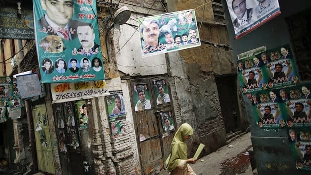 A girl walks in the old part of Lahore decorated with pre-election posters. The so-called 'youth bulge' has dramatically changed the demographic makeup of Pakistani society, and a staggering 40 million Pakistanis will be eligible to vote for the first time in the May 11 elections.