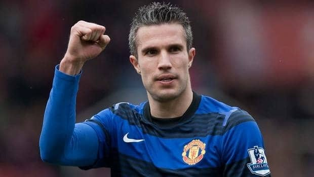 Manchester United's Robin van Persie celebrates after scoring a penalty against Stoke during their English Premier League soccer match on Sunday. It was his first goal in eight weeks.
