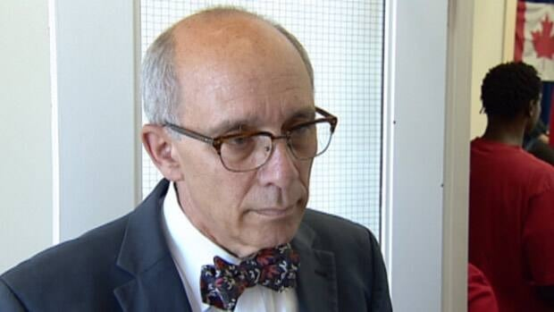 Edmonton Mayor Stephen Mandel says he was disgusted by a National Post column that calls Edmontonians 'twitchy-eyed, machete-wielding savages.'