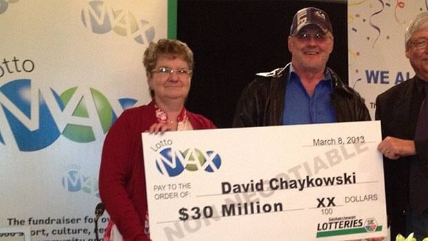David Chaykowski and his wife Gloria posed with a oversized cheque for $30 million.