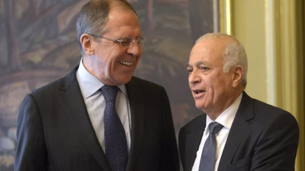 Russian Foreign Minister Sergey Lavrov, left, walks with the Secretary-General of the Arab League Nabil Elaraby, right, prior to the Russian-Arab League meeting in Moscow on Wednesday.