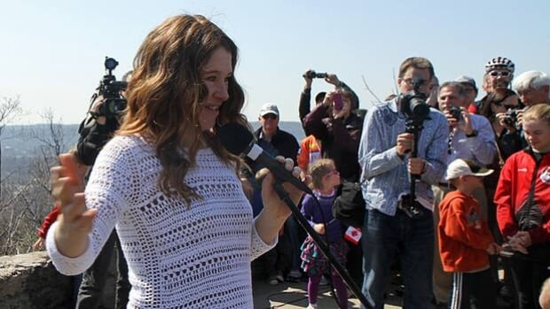 Clara Hughes, who has won Olympic medals in both cycling and speed skating, speaks at the unveiling of a plaque in her honour at Sydenham Hill lookout in Dundas on Saturday.