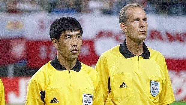 Referee Lu Jun of China, left, seen before a 2002 World Cup assignment, received the harshest penalty possible.