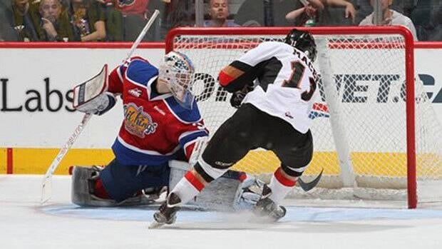 Brooks Macek scored in overtime Sunday to give the Calgary Hitmen a 4-3 win over the Edmonton Oil Kings in the Western Hockey League Eastern Conference finals.