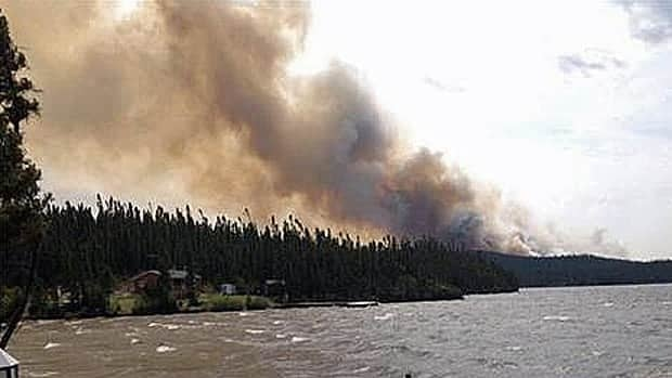A forest fire that began Sunday in western Labrador forced the evacuation of cabins in the area.
