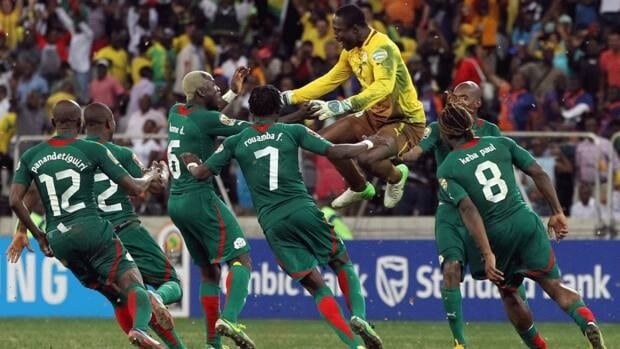 Burkina Faso players celebrate after winning their African Cup of Nations semifinal match against Ghana at Mbombela Stadium in Nelspruit, South Africa on Wednesday.