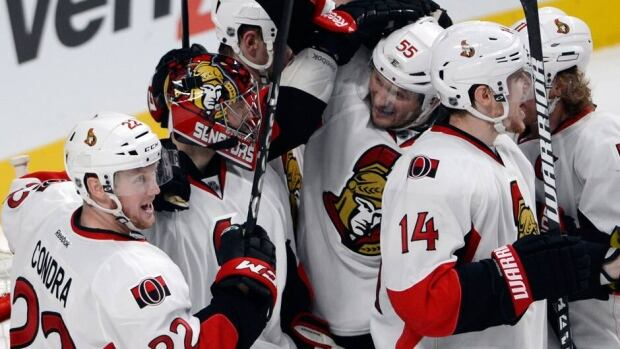 Ottawa Senators goalie Craig Anderson (41) celebrates with teamates after winning their first round playoff series against the Montreal Canadiens on Thursday.