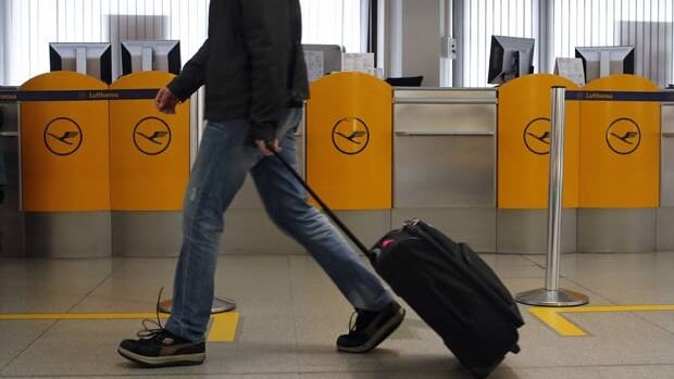 A passenger walks past an empty counter during a warning strike of German air carrier Lufthansa ground personnel at Tegel airport in Berlin on Monday.