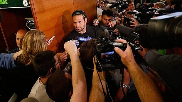 New York Jets quarterback Mark Sanchez, centre, talks to reporters during a locker room availability at the team's NFL practice practice facility in Florham Park, N.J., on Thursday.