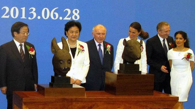 The two bronze sculptures were officially unveiled Friday at a Bejing ceremony attended by China's Vice Premier Liu Yandong (second from left), French billionaire François Pinault (centre), Kering CEO François-Henri Pinault (second from right) and his wife, actress Salma Hayek (right).