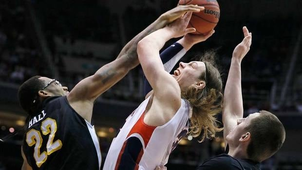 Gonzaga's Kelly Olynyk, centrr, is sandwiched between Wichita State's Carl Hall, left and Demetric Willimas during the first half of their Saturday night game. Gonzaga was upset and eliminated.