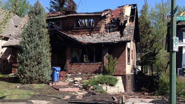 Fire crews responded just after midnight Saturday morning to a fire in southwest Calgary that destroyed one home and damaged another.