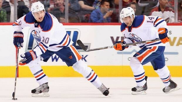 Edmonton Oilers forwards Shawn Horcoff, left, and Jordan Eberle were on hand Wednesday while councillors debated a cost-shared deal for the $480 million US arena.
