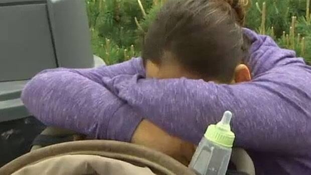 Emily Moar, Morgan's mom, sits distraught outside the hospital in Winnipeg on Wednesday.