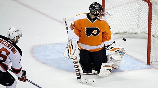 Ilya Bryzgalov watches as the puck goes into the net in an April 18 game, one of his last in a Philadelphia uniform.