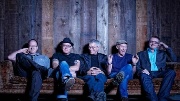 Spirit of the West's John Mann, second from the right, said he doesn't 'want to feel embarrassed' by his diagnosis. The group said Monday it plans'to carry on.'