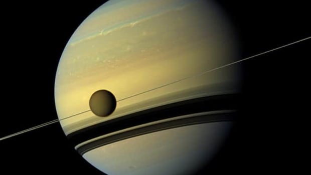 Saturn has 62 confirmed moons. The largest is Titan, seen here passing in front of Saturn in 2012.