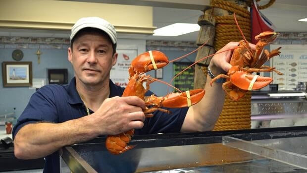 Bernard Lanteigne of Jessinik's Fish Market in Sudbury recently found two orange lobsters in his shipment from the east coast.