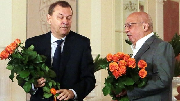 Vladimir Urin, the newly appointed director general of the Bolshoi Theater, is seen at left with his predecessor Anatoly Iksanov at a Tuesday news conference in Moscow